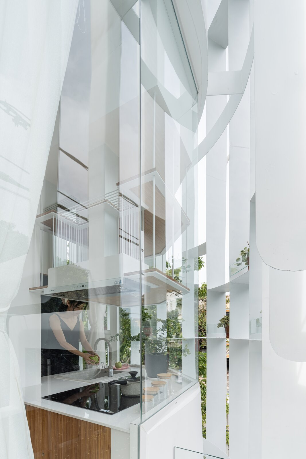 Exterior, Glass Siding Material, and Metal Siding Material  Photo 8 of 23 in A Translucent Tower in Vietnam Invites Visitors in for a Cup of Coffee