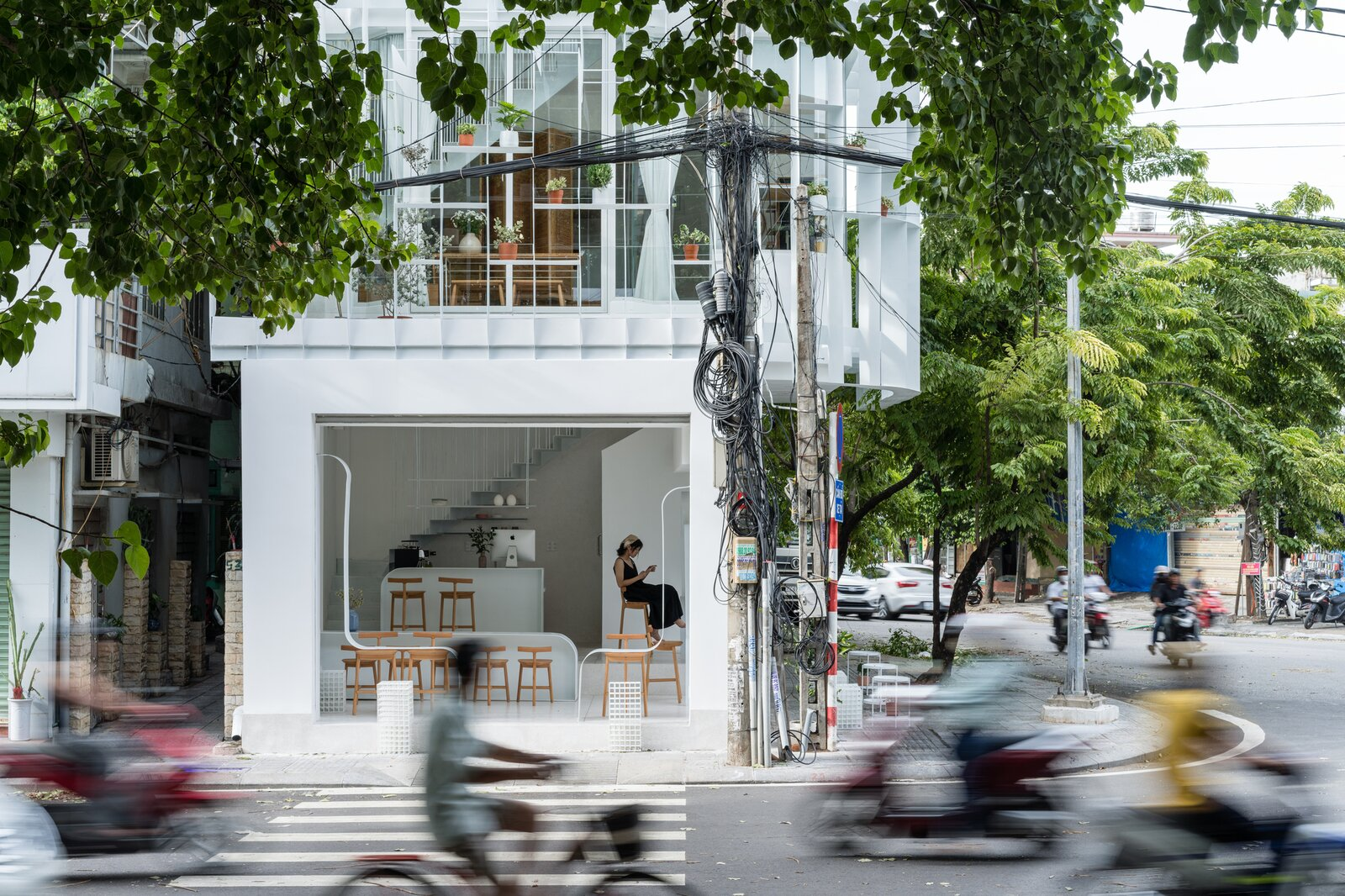 Exterior, Glass Siding Material, and Flat RoofLine  Photo 3 of 23 in A Translucent Tower in Vietnam Invites Visitors in for a Cup of Coffee