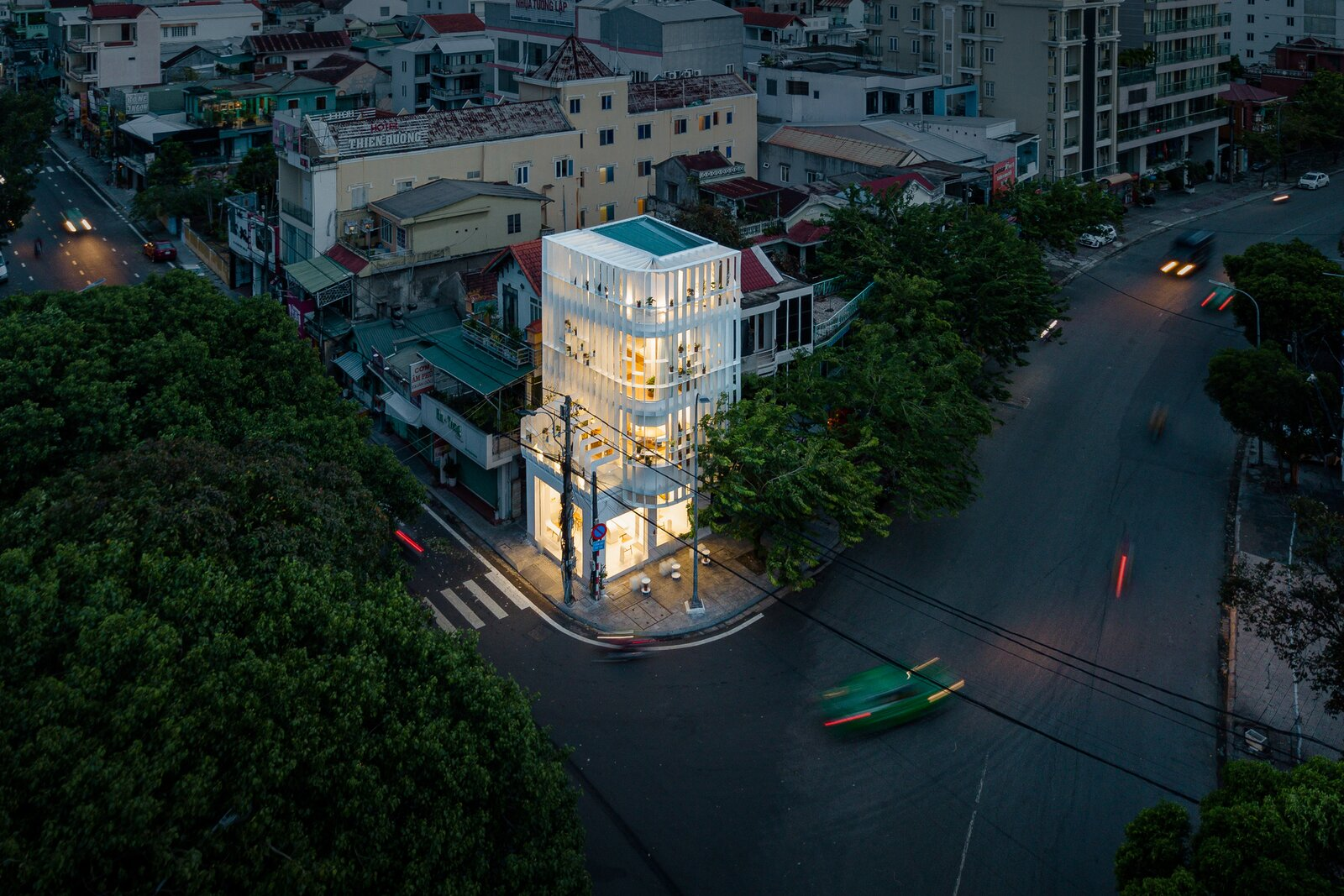 Exterior, Flat RoofLine, and Glass Siding Material  Photo 4 of 23 in A Translucent Tower in Vietnam Invites Visitors in for a Cup of Coffee