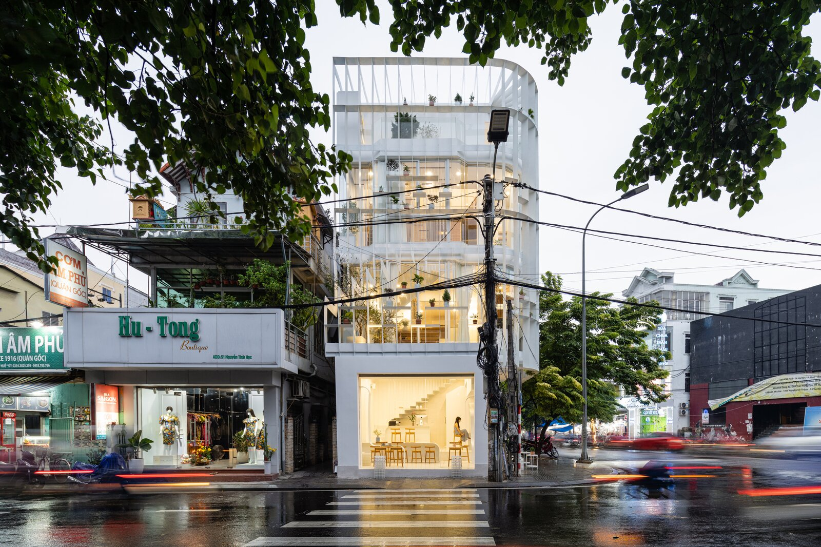Exterior, Flat RoofLine, and Glass Siding Material  Photo 5 of 23 in A Translucent Tower in Vietnam Invites Visitors in for a Cup of Coffee