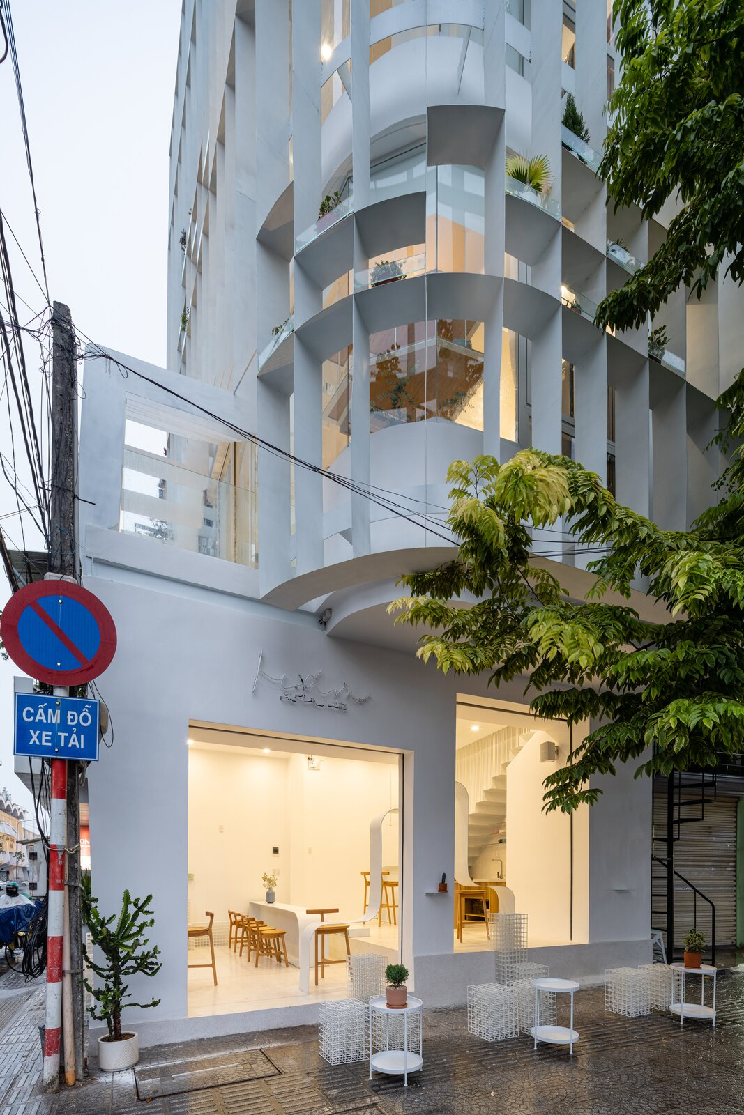 Exterior, Glass Siding Material, and Flat RoofLine  Photo 2 of 23 in A Translucent Tower in Vietnam Invites Visitors in for a Cup of Coffee