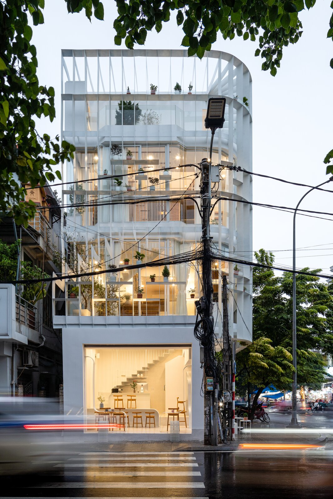 Exterior, Glass Siding Material, and Flat RoofLine  Photo 1 of 23 in A Translucent Tower in Vietnam Invites Visitors in for a Cup of Coffee