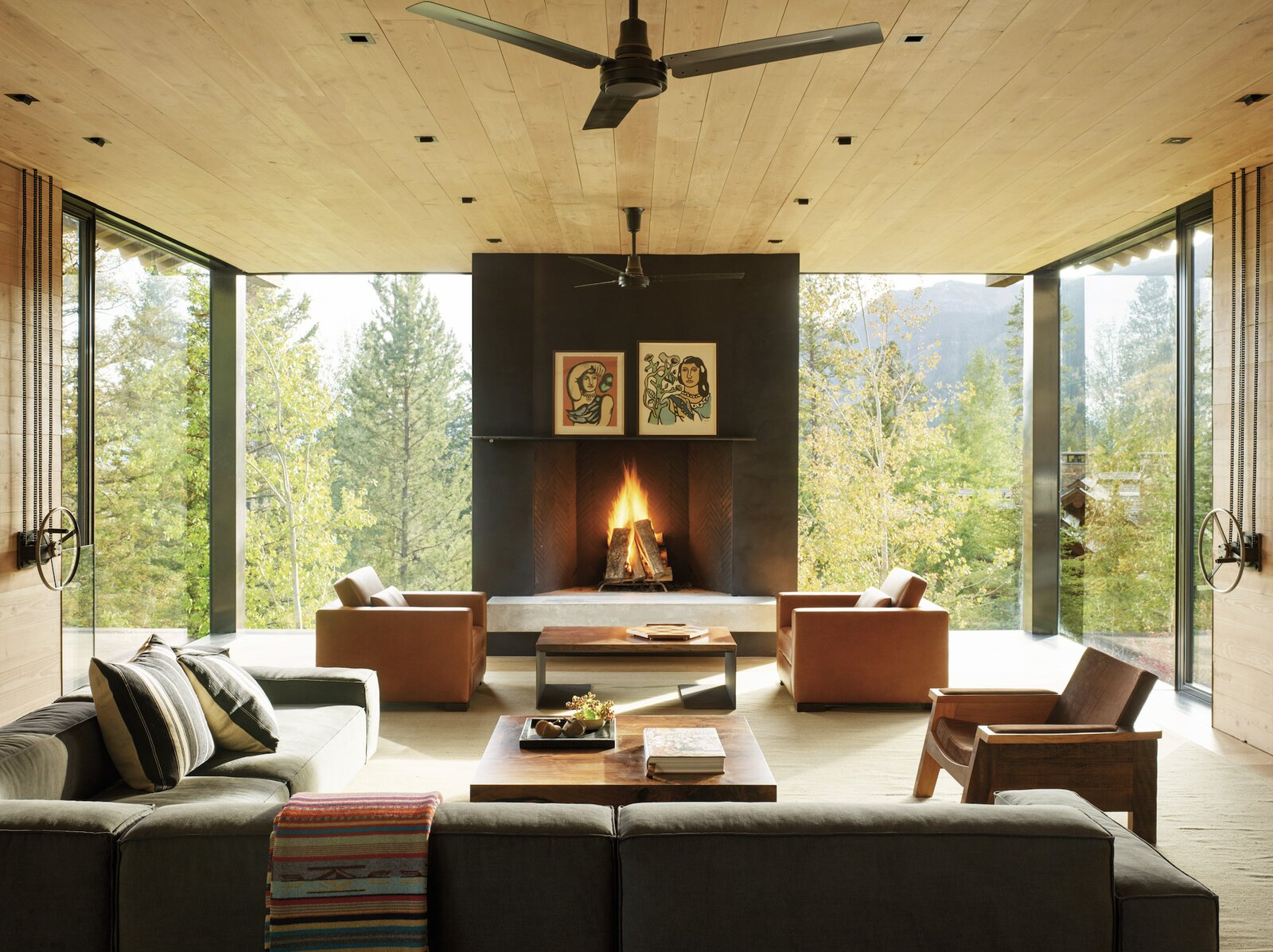Living Room, Standard Layout Fireplace, Recessed Lighting, Sectional, Light Hardwood Floor, Rug Floor, Coffee Tables, Chair, and Wood Burning Fireplace  Photos from A Kinetic Facade Opens This Spectacular Mountain House to the Grand Teton Landscape