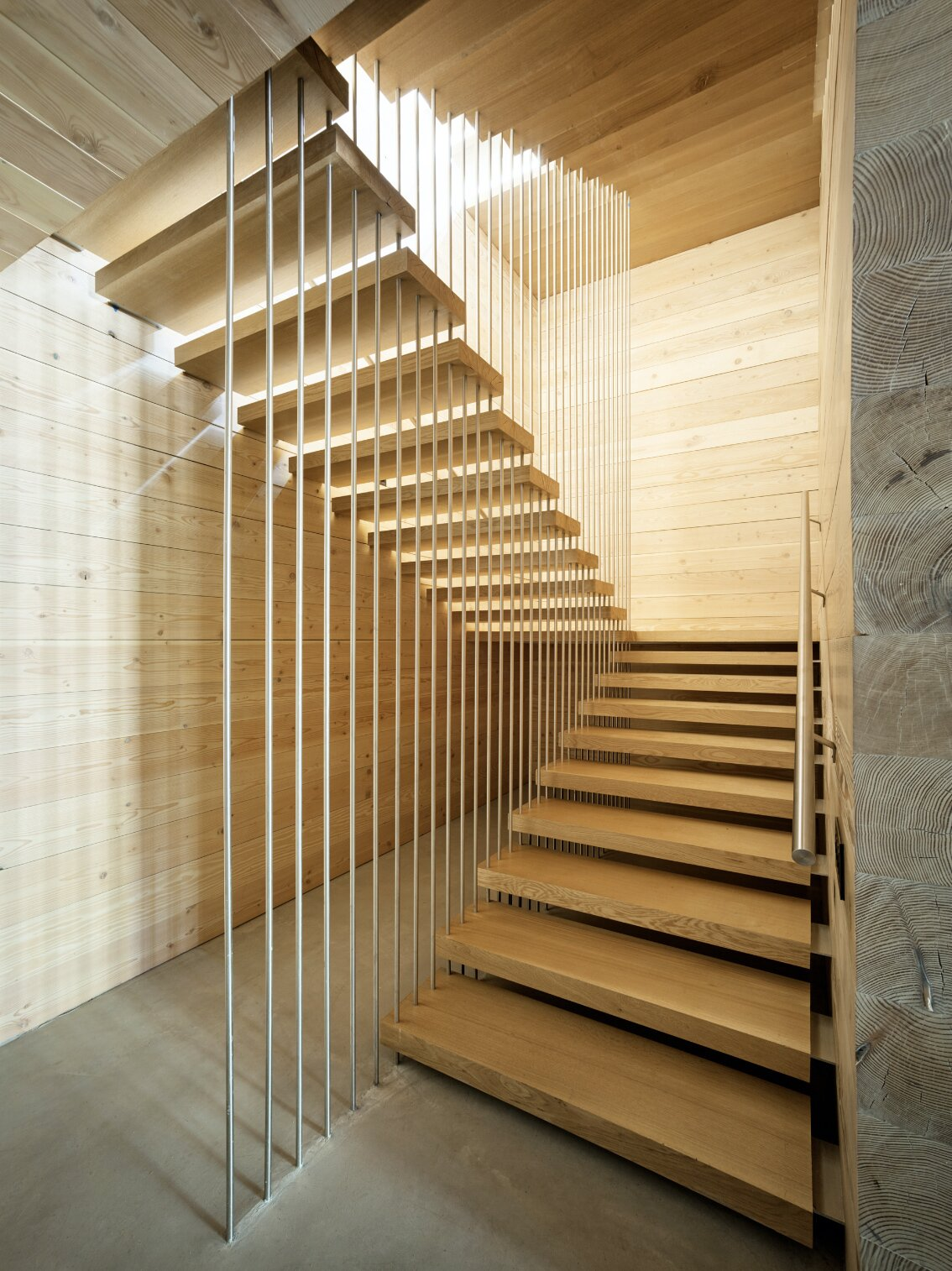 Staircase, Metal Railing, and Wood Tread  Photos from A Kinetic Facade Opens This Spectacular Mountain House to the Grand Teton Landscape