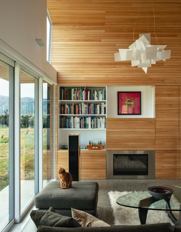 Living, Sofa, Ottomans, Pendant, Coffee Tables, Bookcase, Terrazzo, Storage, and Gas Burning  Living Storage Pendant Photos from A Musician Couple's Wedge-Shaped House Echoes the Majesty of the New Zealand Landscape
