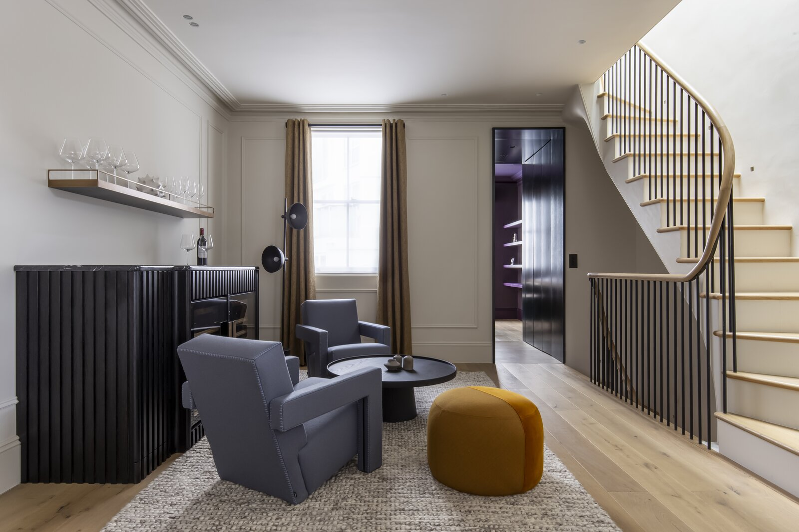 Living, Recessed, Chair, Ottomans, Bar, Medium Hardwood, Coffee Tables, Storage, Floor, and Rug  Living Medium Hardwood Recessed Storage Photos from A Candy Pink Pied-à-Terre in London Is Sumptuously Reimagined