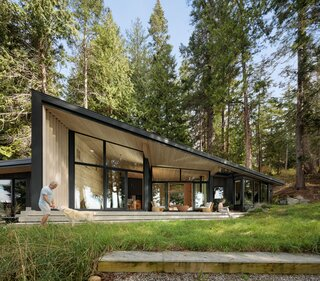 An Angular Black Cabin Rises From the Woods Near Vancouver