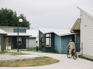 One Man's Tiny Home Acts as a Prototype in a Village for Those Who Lacked Housing