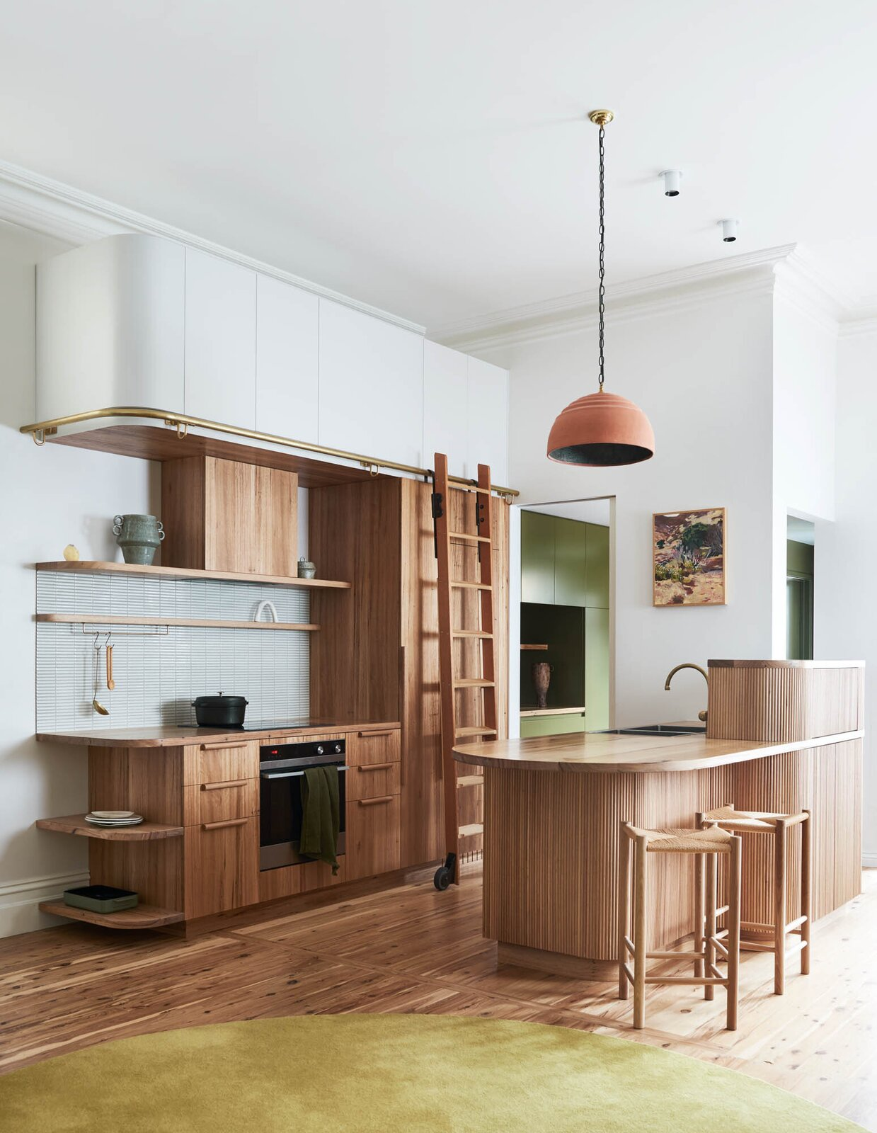 Kitchen, Wood Counter, Drop In Sink, Medium Hardwood Floor, Ceramic Tile Backsplashe, Cooktops, Pendant Lighting, Refrigerator, Wood Cabinet, and Wall Oven  Dwell's Favorite Photos from A Cramped Melbourne Victorian Gets an Earthy Refresh Inspired by the Australian Bush
