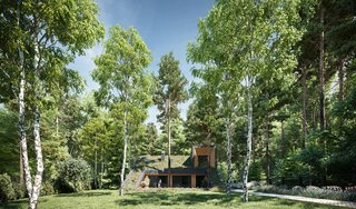 A Passive House on the Outskirts of Moscow Blends Into Its Forested Surroundings