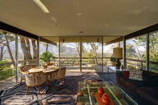 Enjoy sweeping vistas of the San Jacinto Mountain range and downtown Palm Springs just like Steve did. While you're at it, try contemplating the pattern of the rug by Edward Fields, if you can.
