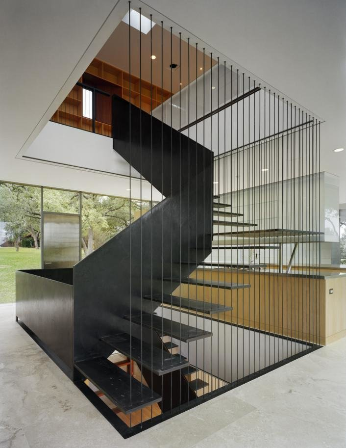 Staircase, Metal Tread, and Metal Railing  Floating Box House by Gluck+
