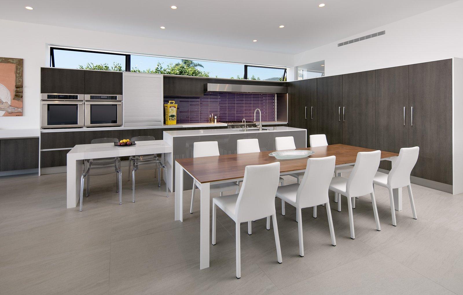 Purple mosaic tile adds a pop of color the the minimal kitchen.   Glenhaven Residence by Abramson Teiger Architects