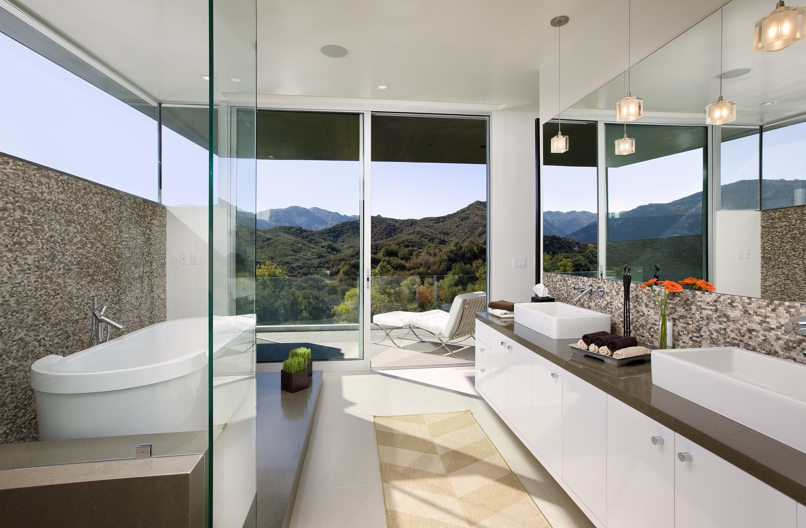 A stunning bathroom opens onto a patio for striking canyon views.   Lima Residence by Abramson Teiger Architects