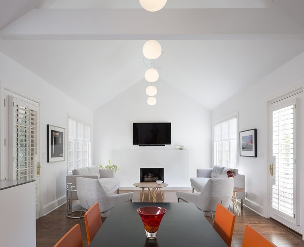 The renovation dramatically increased natural light in the rooms and replaced tired finishes with a modern palette.