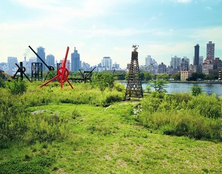 "The park, newly transformed into a public art space in 1986. Mark di Suvero's red-painted steel sculpture, ""Old Glory,"" is one of the pieces pictured."