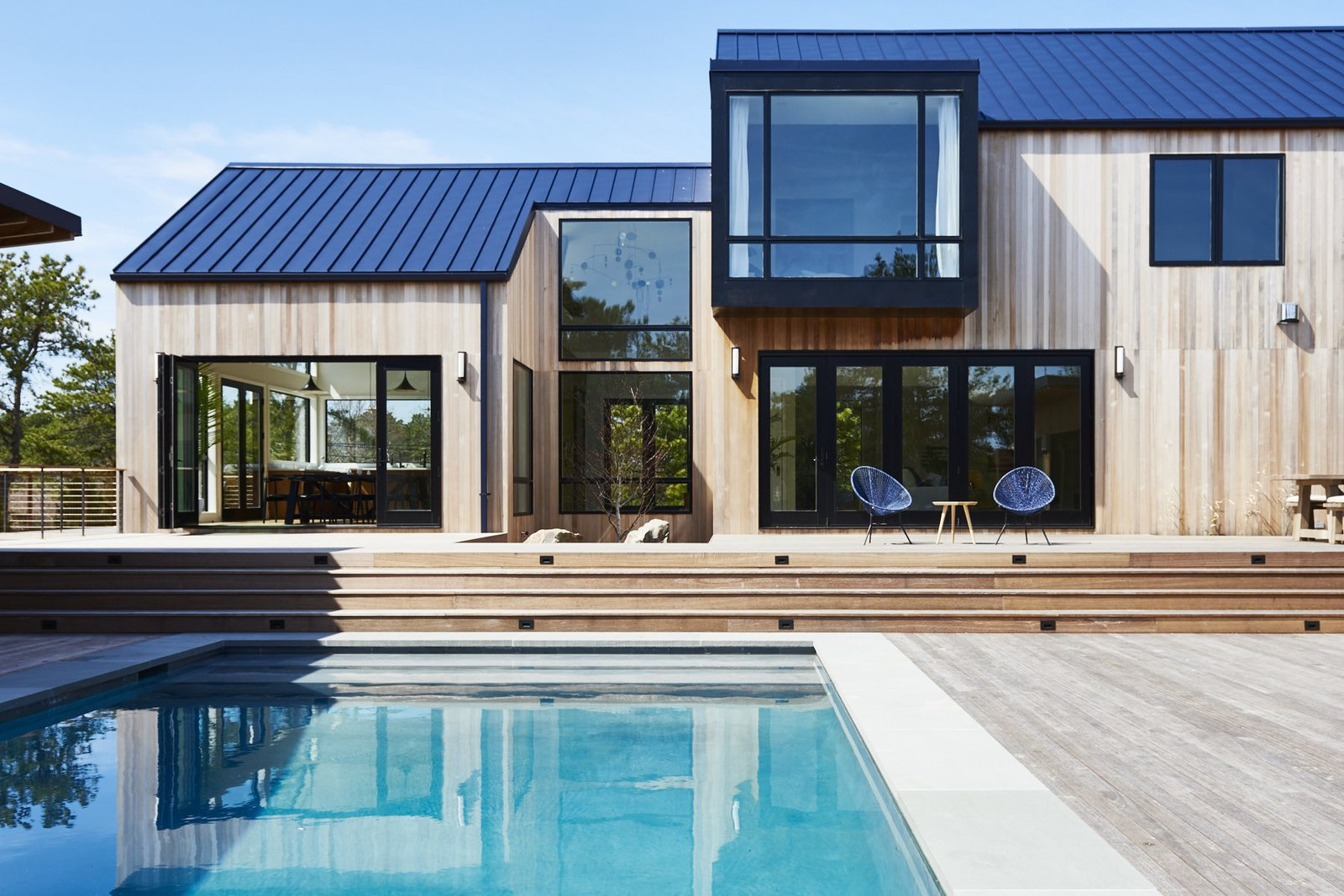 Outdoor, Wood Patio, Porch, Deck, Large Pools, Tubs, Shower, and Swimming Pools, Tubs, Shower  Photo 1 of 7 in You Won't Lose Your Wi-Fi Connection at This Hamptons Retreat