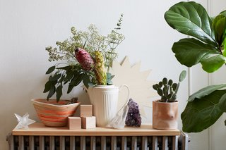 500 Square Feet Is Just Right in Greenpoint - Photo 4 of 6 - One vignette, propped on a radiator, features a pot by Isaac Nichols, a rope basket by Trish Andersen, and a crystal from Sprout Home.