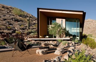One of our featured homes is the Jarson Residence, designed by Will Bruder of Will Bruder Architects and characterized by a simple shed roof with deep overhangs. The exterior of the sculptural structure is covered with rusted steel and copper that blends well with the surrounding rocky topogrpahy.
