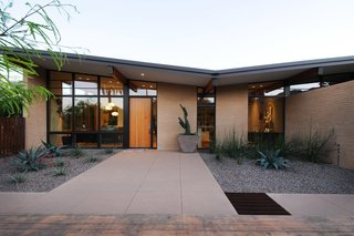 Taking it to the Desert With Dwell Home Tours - Photo 10 of 12 - The Montecito residence—designed by Kristine Woolsey, now of MAYA Design—is yet another home we'll be sharing. Working with a midcentury gem that the homeowners wished to preserve, Woolsey updated it in ways that would make it more functional for a growing family. The first design decision they made was to embrace the existing butterfly roof and turn it into a thematic element.
