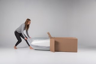 When a Luxi mattress is delivered to your door, it's held within a convenient box and carefully rolled up in a protective wrap.