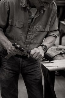 Taken at the workshop in Lancaster County, this image shows how each piece is carefully produced from start to finish. One of the Smilow craftsmen is shown here making precise notches into a piece of American walnut.