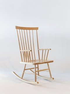Today's rendition of the Rocking Chair, shown here in the natural ash finish, relies on its clean lines and meticulous craftsmanship.