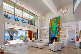 Located in the Hope Ranch neighborhood of Santa Barbara, California, this striking home sits on an almost four-acre bluff with over 200 feet of ocean contact. The art-adorned fireplace acts as the centerpiece of the living room that opens up to unobstructed views of the Pacific Ocean.