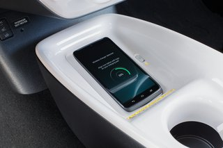 With the Qi-compatible wireless smartphone charging system*, you can charge your phone by placing a compatible device onto the nonslip surface.  *The Qi wireless charging may not be compatible with all mobile phones, MP3/WMA players, and like models. When using the wireless charging system, avoid placing metal objects between the wireless charger and the mobile device when charging is active. Doing so may cause metal objects to become hot and could cause burns. To prevent damage to devices, do not leave the devices in the vehicle. Temperature inside may become high, resulting in damage to the device.