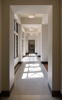 Garcia placed Marvin windows all along an extensive corridor. The windows let natural light pour in while allowing the x-shaped wood beams from the exterior overhangs to reflect their shadows along the limestone flooring.