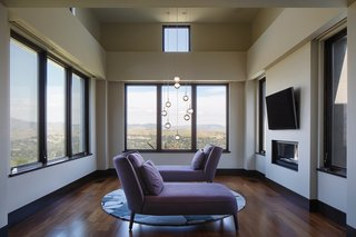 The sitting area off the master bedroom reveals views of Mount Diablo and the surrounding landscape. The inside of the Marvin casement windows are made up of Douglas fir that's been finished in a dark wood stain. For the exterior, he opted for aluminum-clad casements with a bronze finish.