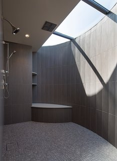 For the master bathroom, he worked with a fabricator to design a custom crescent-shaped skylight that lets light stream into the shower.