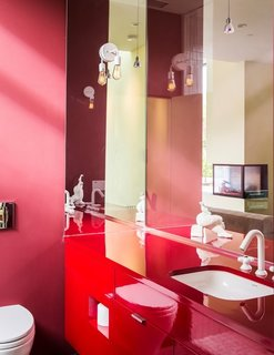 The vibrant color scheme is continued throughout the property, even into the smallest of spaces—as shown here in one of the bathrooms.