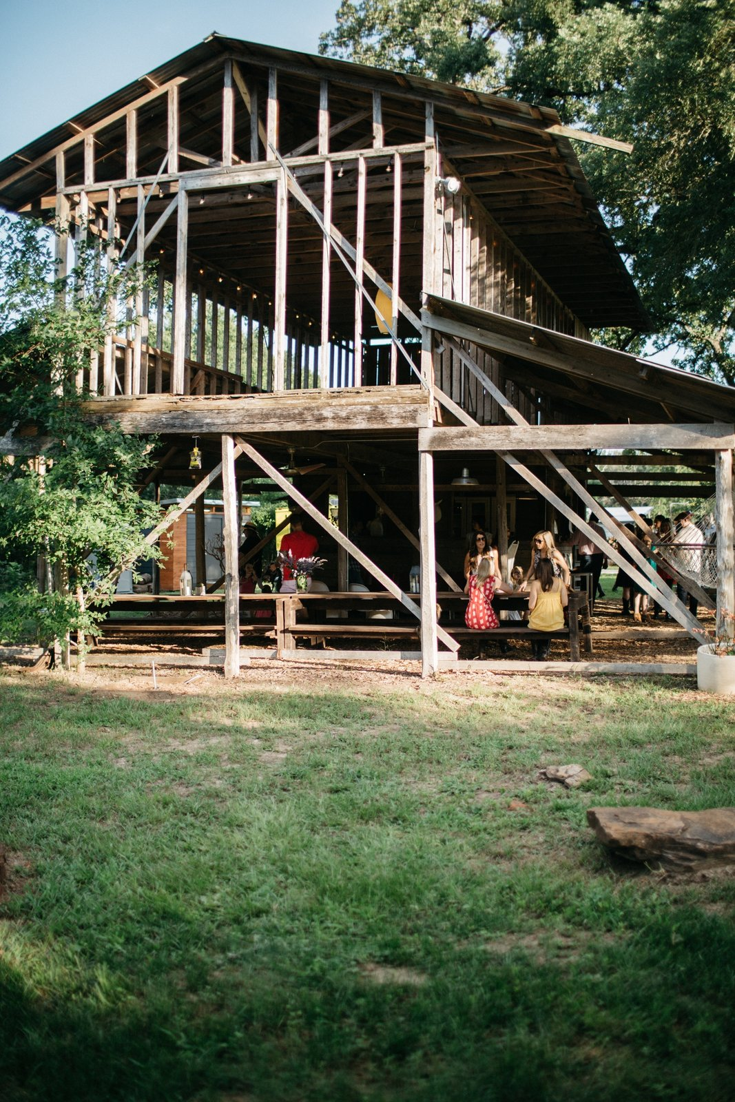 Exterior, Wood Siding Material, and Barn Building Type In the open communal barn, the resident family often hosts dinner parties to be enjoyed alfresco with a four-course meal.  Photo 8 of 8 in A Texas Camping Spot Complete With Yurts and Miniature Donkeys