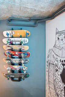 A custom board rack provides a space for the kids of the house to show off their prized decks.