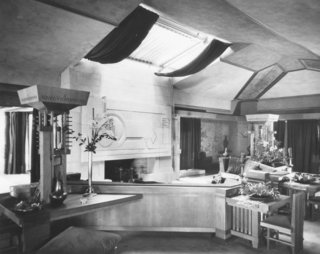 """The Hollyhock House reveals Wright's usage of an open concept plan. Our house docent described to us, """"For Wright, compression was always followed by relief. After passing through low entry hallways and multiple columns, you then enter into large open spaces through dramatic passages."""""""