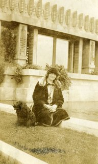 Shown here is Aline Barnsdall herself, lounging on the grounds of the Hollyhock House with her dog. The story of the residence could not be told without the powerful presence she held over the project.