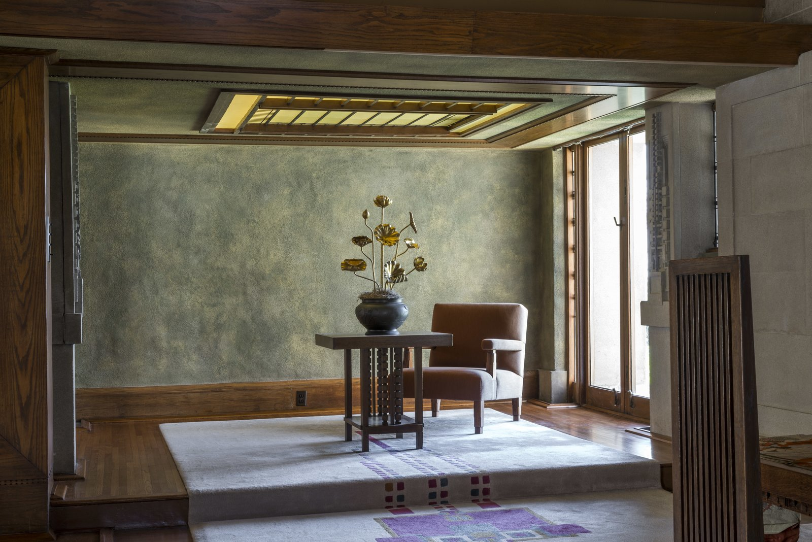 Since Barnsdall was such a strong-minded woman who knew what she wanted, she only let Wright design the furnishings for two of the rooms, including the living room and the dining room. The rest of the house was filled with items she had collected throughout her travels.  Photo 7 of 14 in Iconic Perspectives: Frank Lloyd Wright's Hollyhock House