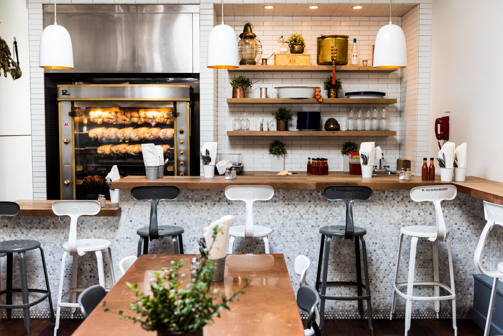 When you first walk into Souvla, your eye is drawn to the rotisserie, which has become the main focus of the restaurant. It reinforces its locally-sourced, back-to-basics motto. A chunk of the Grecian objects displayed on the shelves were from the owner's Grandfather's restaurant in Boston.  Photo 2 of 7 in A San Francisco Greek Restaurant That's Become a Neighborhood Staple