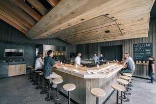 At KazuNori's new second location, Marmol Radziner built the U-shaped bar out of bleached eucalyptus wood, while the walls are made of plaster and board-and-batten wood. The sculptural dropped ceiling is constructed of bleached rustic white oak and lined with a warm lighting scheme.