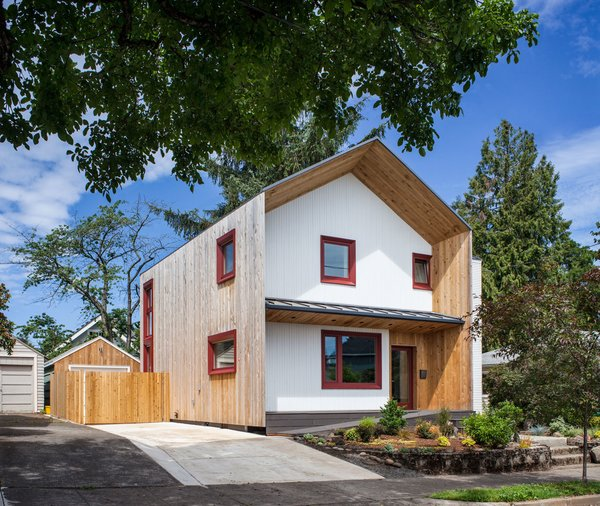 The exterior of the Phoenix Passive House is lined with locally milled cedar siding. With a dual-wall construction, the structure is covered with an Agepan weather protective barrier—also known as wax-impregnated fiberboard. The triple-paned windows were fabricated in Seattle and framed with Oregon-grown FSC certified wood. They're outfitted with automated exterior solar shades. Additionally, the house is prewired for a car charging station.