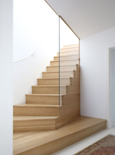 Robinson built an airy wood stairway to bring more light up onto the second and third floors. The updated third floor looks out to views of Portland's West Hills.