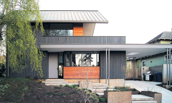 The team used board-formed concrete and FSC certified framing lumber that they cleaned and reused to frame the house. During construction, they wanted to make sure they'd be able to install a green roof in the near future on the flat areas. To do this, they pre-engineered the desired sections in order to hold the weight.