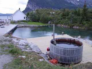 When you arrive at Manshausen, you'll find a hot tub that you can enjoy at your leisure. It holds up to 14 people and leads down to a dam that holds salt water that's pumped into the contained area to keep it fresh.
