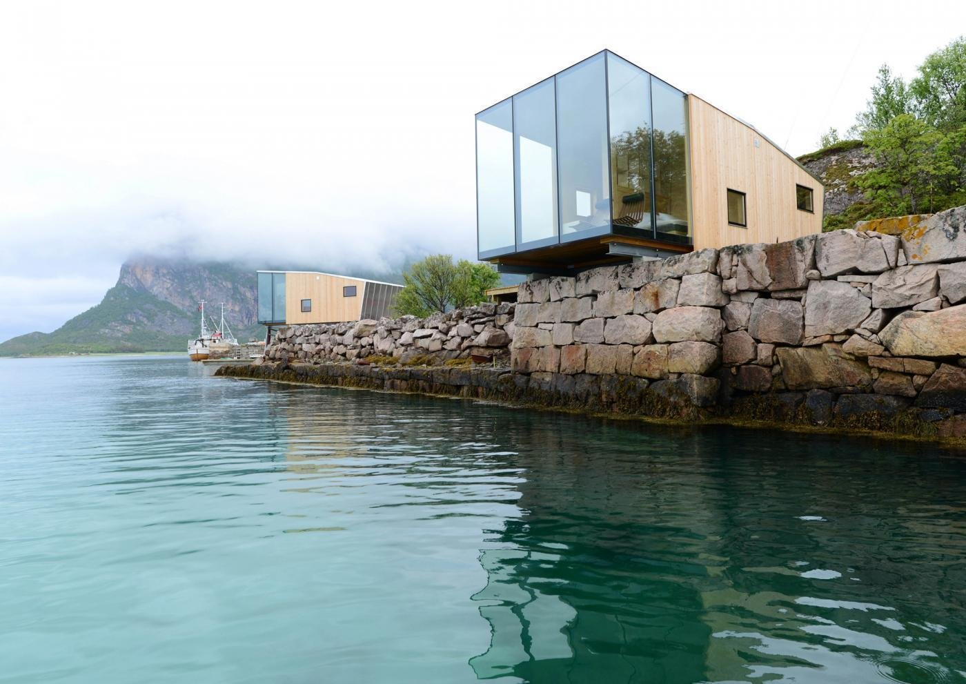 Exterior, Wood Siding Material, House Building Type, and Glass Siding Material This boutique hotel on Norway's Manshausen Island is made up of four sea cabins—one of which juts out from a natural ledge. Each of them fit two to four travelers or a family of five.  Photo 1 of 8 in Have You Ever Wanted to Stay in a Norwegian Sea Cabin?