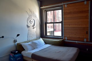 Every room has a different setup, many of which include custom wall murals that are usually quirky and lighthearted. Industrial and rough details make you feel like you're camping, including wool quilts from Pendleton for the Ace Hotel, barn door sliding windows, heavy metal hardware, and old claw foot bathtubs.