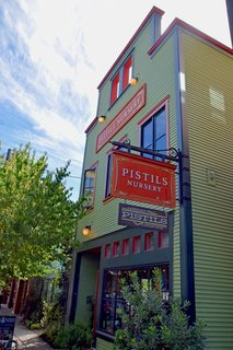 The red and green facade of Pistils Nursery stands proud in the heart of the Mississippi District. It's filled with indoor and outdoor plants and nature-inspired goods.