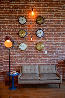 In the retail section of the space, you'll find different room-like vignettes that make you feel like you're in a house, rather than a century-old warehouse retail space.