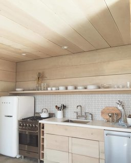 Working Your Way to a Blended Home - Photo 10 of 11 - His backyard fort now has a kitchen and is filled with a ton of cedar and a mix of different calming textures that reflect his beach house-vibe.