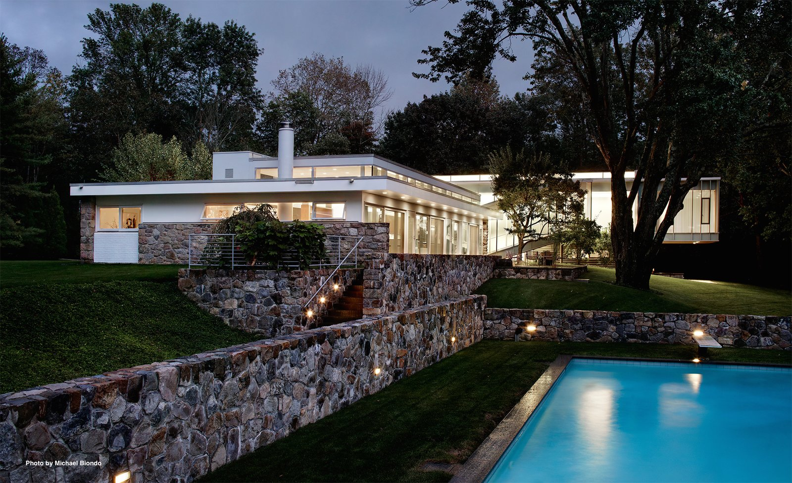The property sits on three acres and includes a heated pool, a pool house that was originally designed in 1981, a Mori-designed wine cellar, and a sunning deck above the pool house. The terrace features a waterfall and fern garden.  Photo 2 of 9 in Marcel Breuer's Revived Home Could be Yours for Just Under $5 Million